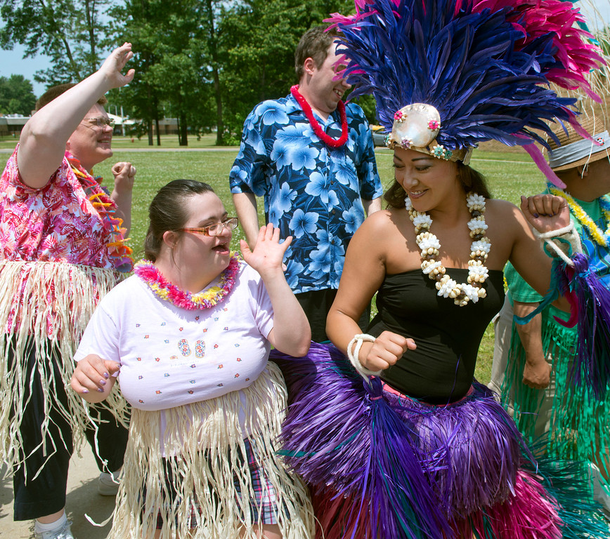 . Duncan Scott/DScott@News-Herald.com Jocelyn Pierce dances with Leilani Bowersock of OHana Aloha during a luau on June 18 at the Lake County Board of Developmental Disabilities/Deepwood Vocational Guidance Center.