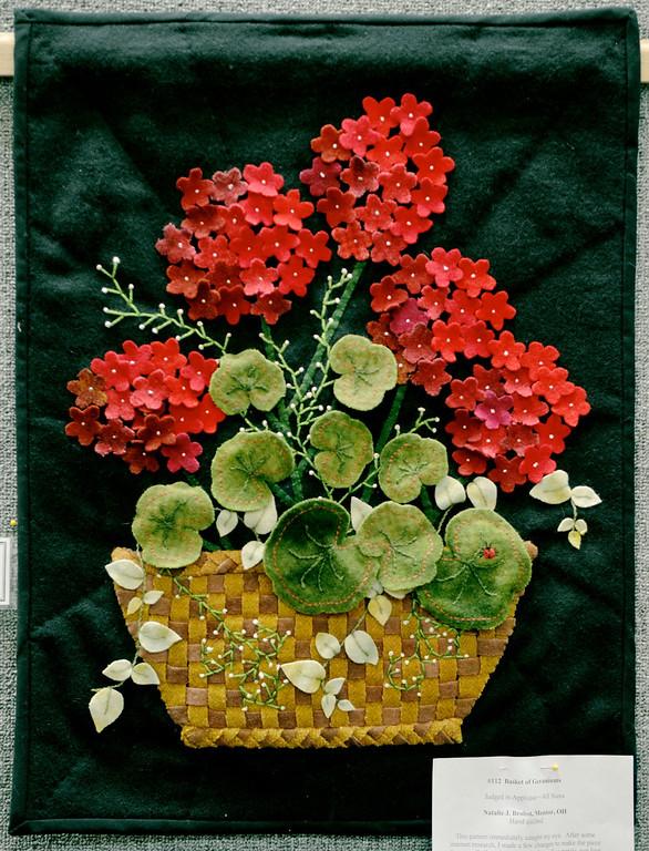 ". Jeff Forman/JForman@News-Herald.com \""Baskets of Geraniums\"" by Natalie J. Brobst, of Mentor."