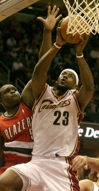 . Maribeth Joeright/MJoeright@News-Herald.com                    Cavaliers forward LeBron James goes up for the basket as Trail Blazers forward Zach Randolph tries to interfere in the second period Friday at Quicken Loans Arena.