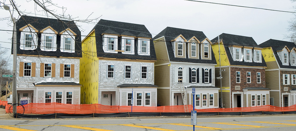. Duncan Scott/DScott@News-Herald.com The 2014 Lake County YMCA Dream House is on the left, one of the brownstones under construction at The Residences at Willoughby Pointe in downtown Willoughby. Designers presented their plans for the rooms today at the Central YMCA in Painesville.