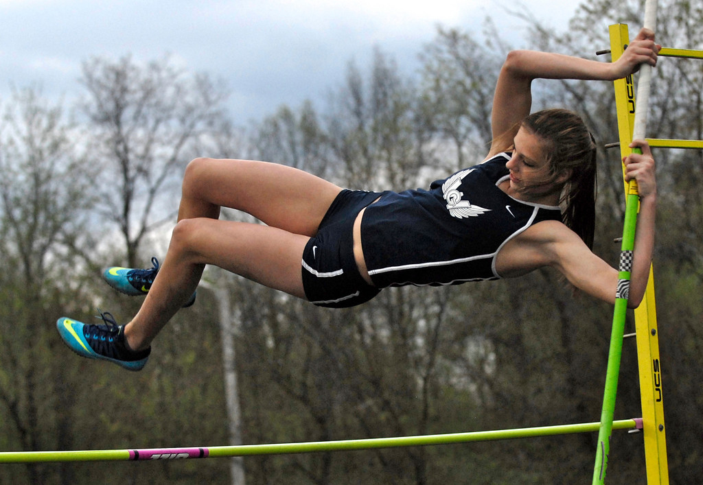 . Jeff Forman/JForman@News-Herald.com Audrey Rabe clears 6-6 early in the pole vault competition during the Mayfield 2014 Track and Field Invitaional May 9 at Mayfield High School. Rabe went on to break the area record, clearing 11-8.