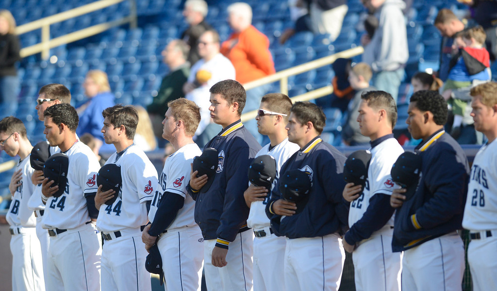 . Maribeth Joeright/MJoeright@News-Herald.com Members of the Lake County Captains are shown during the National Anthem before their exhibition game against the Akron Rubberducks.