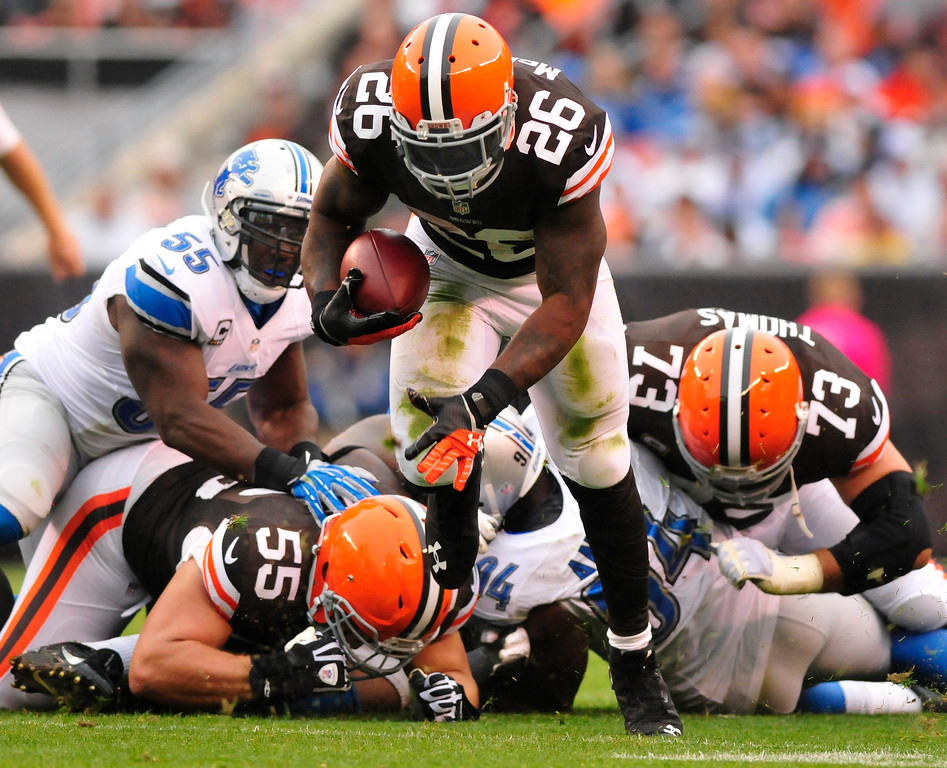 . Sam Greene/The Morning Journal Browns running back Willis McGahee (26) breaks threw for extra yards during the second quarter of the NFL week six game between the Cleveland Browns and Detroit Lions at FirstEnergy Stadium in Cleveland, Ohio, on Sunday, Oct. 13, 2013. McGahee 37 yards on 10 attempts against the Lions.