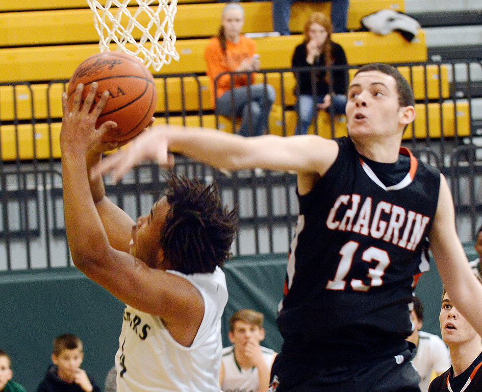 . Maribeth Joeright/MJoeright@News-Herald.com Lake Catholic\'s Kareem Haddix is fouled by Chagrin\'s Jack Karyo in the fourth quarter of the Division II district final game, March 8, 2014. Lake defeated Chagrin Falls by a score of 68-59.