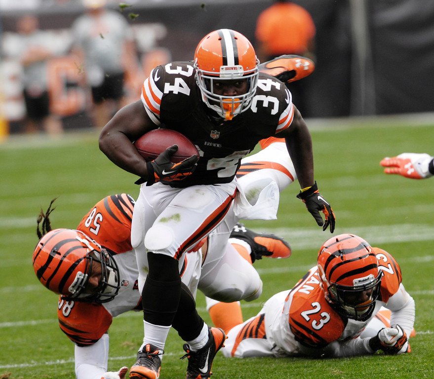 . Jeff Forman/JForman@News-Herald.com Browns running back bobby Rainey eludes Bengals defenders Rey Maualuga and Terence Newman in the third quarter of the Browns\' win Sunday at FirstEnergy Stadium.