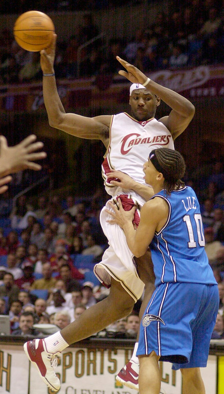 . Maribeth Joeright/News-Herald Cavaliers guard LeBron James does a no look pass over the head of Tyronn Lue during the third period of Monday\'s game at Gund Arena.