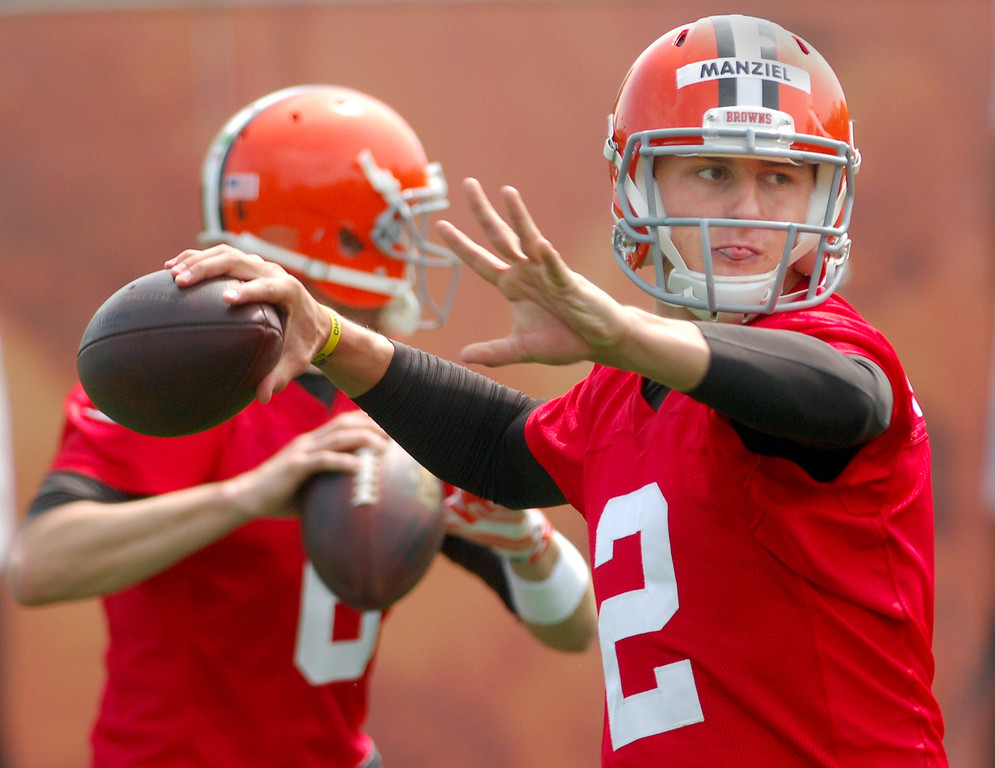 . Michael Allen Blair/Digital First Media Browns\' rookie quarterback Johnny Manziel, front, and quarterback Brian Hoyer take some reps during organized team activities on May 21 in Berea.