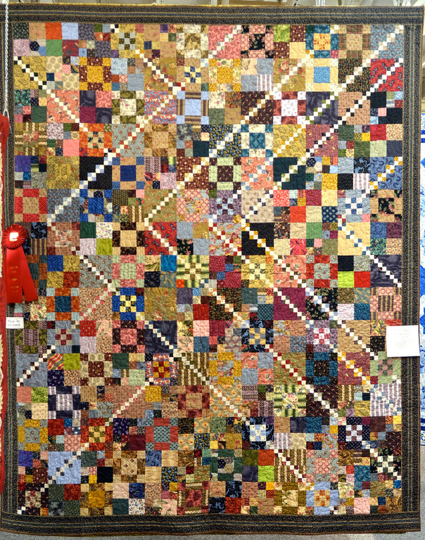 """. Jeff Forman/JForman@News-Herald.com \""""Trail Mix\"""" by Anne Schmidt, of Chardon, won second place in the medium bed quilt category."""