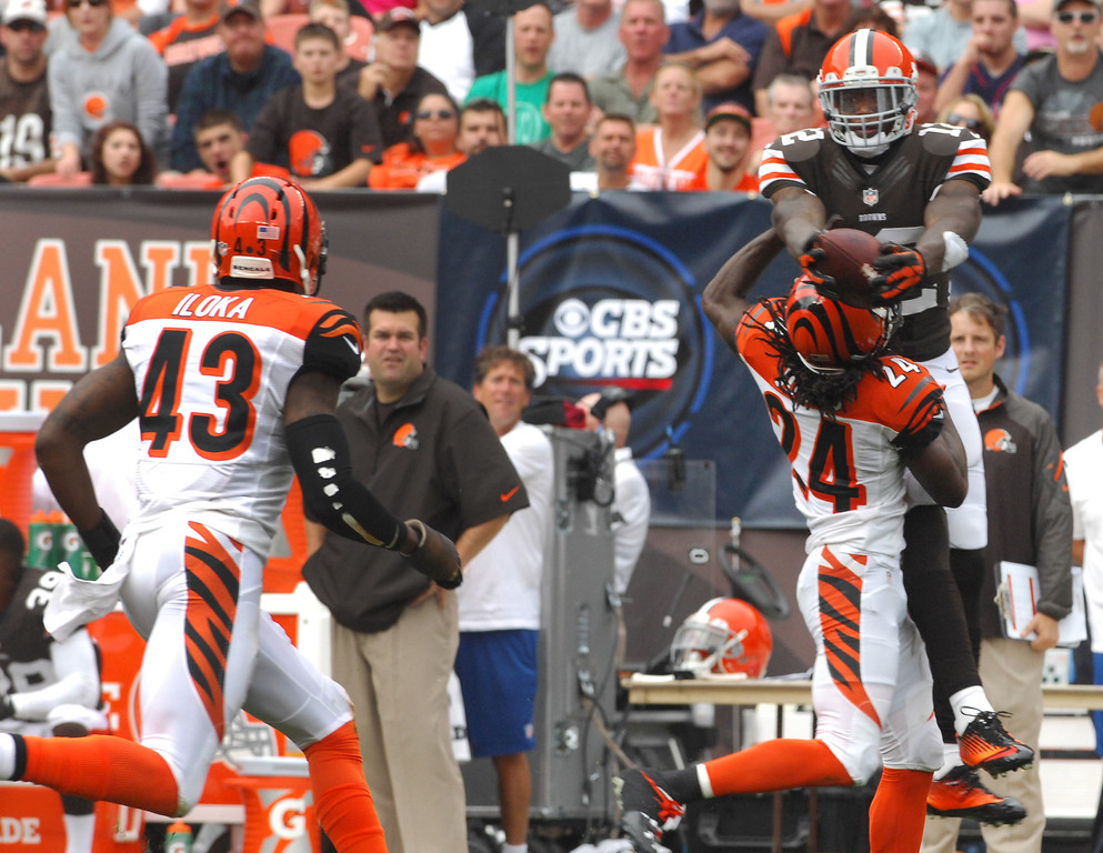 . Michael Allen Blair/MBlair@21st-CenturyMedia.com Browns wide receiver Josh Gordon hauls in a first down pass over top of Bengals\' cornerback Adam Jones during the first quarter versus the Bengals at FirstEnergy Stadium in Cleveland, OH. on Sunday, September 29, 2013.