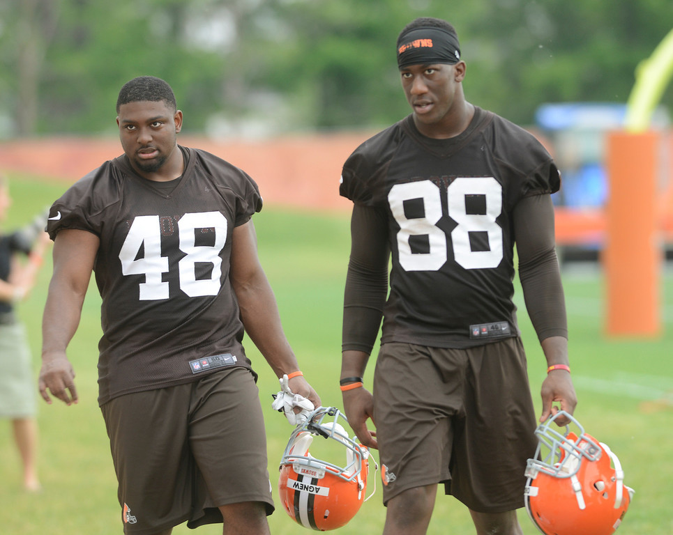 . Maribeth Joeright/MJoeright@News-Herald.com <p> Browns players Ray Agnew and James Oboh leave the field at the end of practice in Berea, June 10, 2014.
