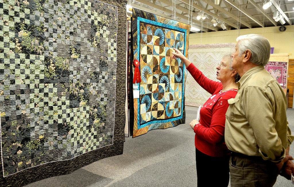 . Jeff Forman/JForman@News-Herald.com Gayle and Gene Santavicca, of Chardon, check out quilts on display at the 23rd Annual Quilts 2014 show Thursday at Lake Metoparks Farmpark.