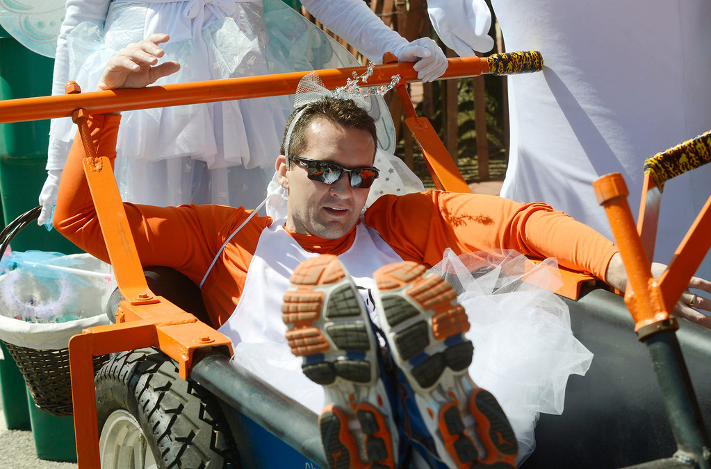. Maribeth Joeright/MJoeright@News-Herald.com<p> Dr. Brian Titus of Chardon Smile Center, relaxes in the team\'s tub after taking second place in the bathtub races at the 85th annual Geauga County Maple Festival on Chardon Square, April 27, 2014.