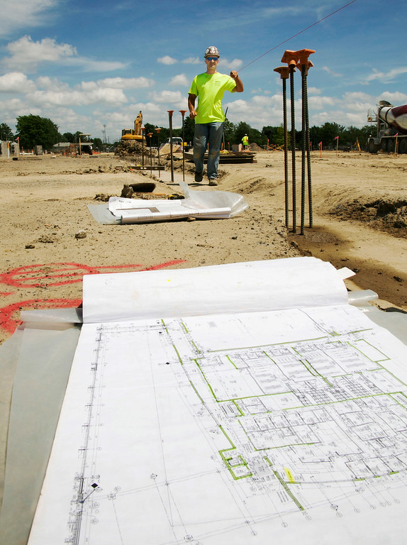 . Michael Allen Blair/MBlair@MorningJournal.com A Construction worker prepares to poor a footer on the new Lorain Admiral King High School in Lorain on June 30.