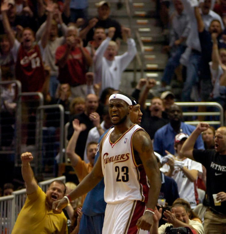 . PHOTO BY DAVID RICHARD LeBron James celebrates after a layup and foul on Washington yesterday in the opening game of the NBA playoffs.