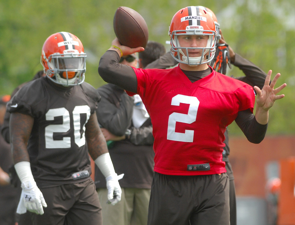 . Michael Allen Blair/MBlair@Digital First Media Browns\' rookie quarterback Johnny Manziel fires a pass as rookie runningback Terrance West looks on at left during organized team activities on May 21 in Berea.