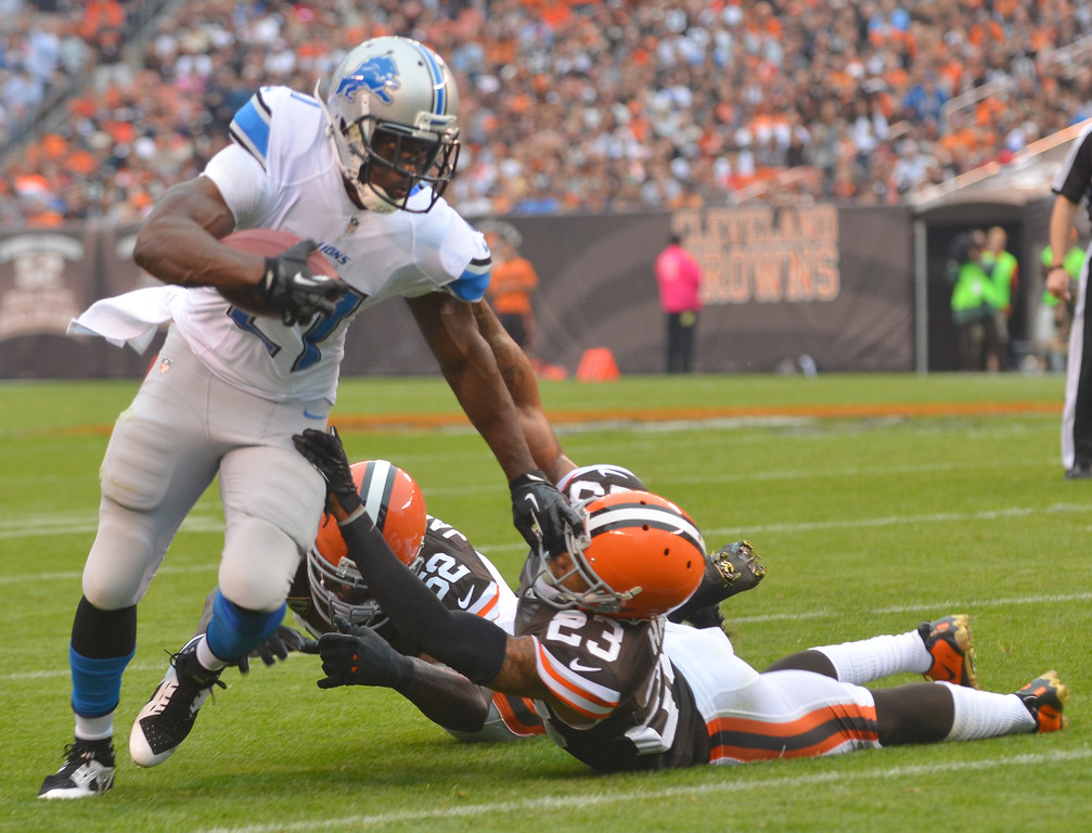 . Michael Allen Blair/MBlair@21st-CenturyMedia.com Lions running back Reggie Bush slips away from Browns\' linebacker D\'Qwell Jackson and defensive back Joe Haden during the first quarter versus the Lions at FirstEnergy Stadium in Cleveland, OH. on Sunday, October 13, 2013.