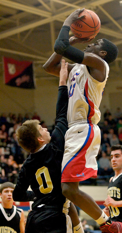 . Jeff Forman/JForman@News-Herald.com Jeremiah Selle, Cornerstone Christian, shoots over Pete Ruthe in the first half of the Patriots\' Division IV Regional semifinal game March 11 against St. Thomas Aquinas.