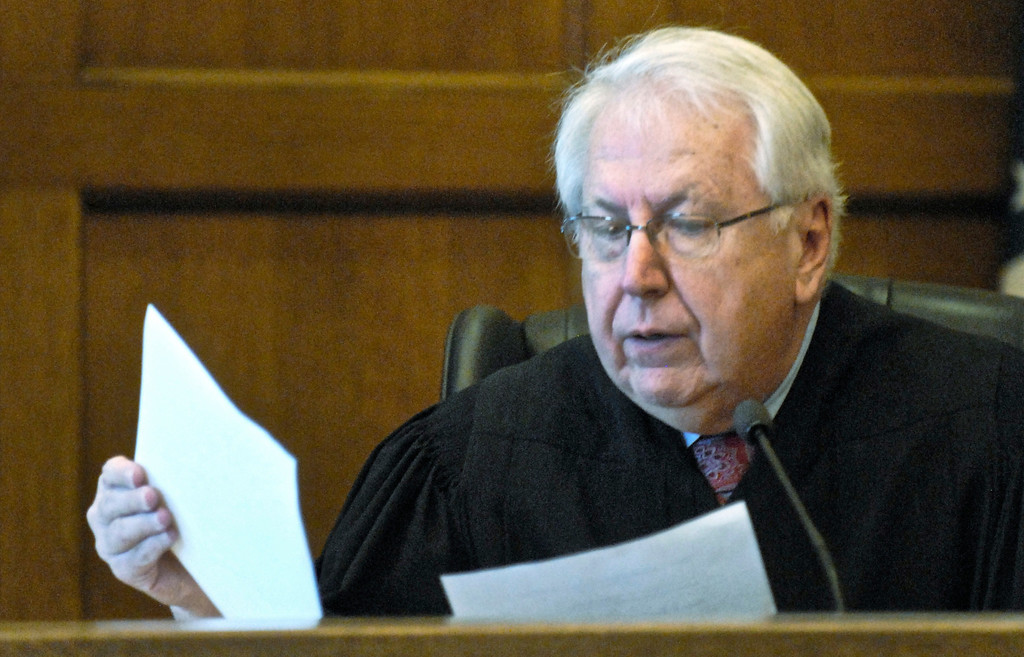 . Jeff Forman/JForman@News-Herald.com Lake County Common Pleas Court Judge Richard L. Collins reads the verdicts Feb. 21 against Nathaniel Brown in the killing of William Andrew Fayne Putzbach.