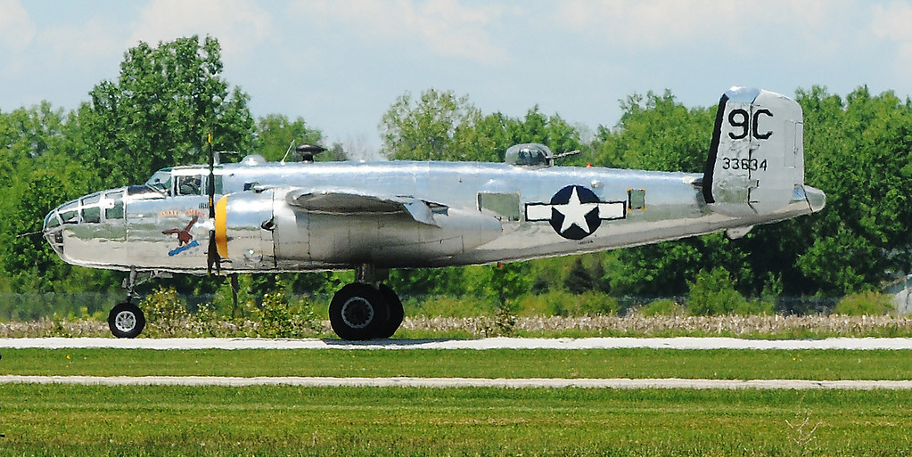 . Jim Bobel/JBobel@MorningJournal.com The B-25 World War II Bomber Yankee Warrior lands after making  serveral  passes over the crowd Discover Aviation Air Show at the Lorain County Regional Airport.