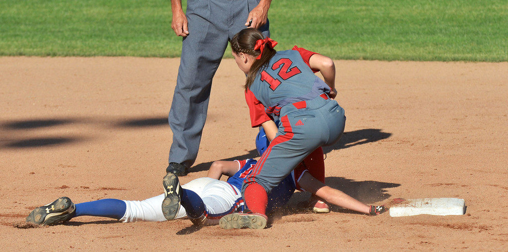 . Jeff Forman/JForman@News-Herald.com Grove City runner Samantha Galiffo is tagged out at second base by Elyria second baseman Mackenzie Phares in the first inning of the Pioneer\'s 9-1 state semi final loss June 5 at Firestone Stadium in Akron.