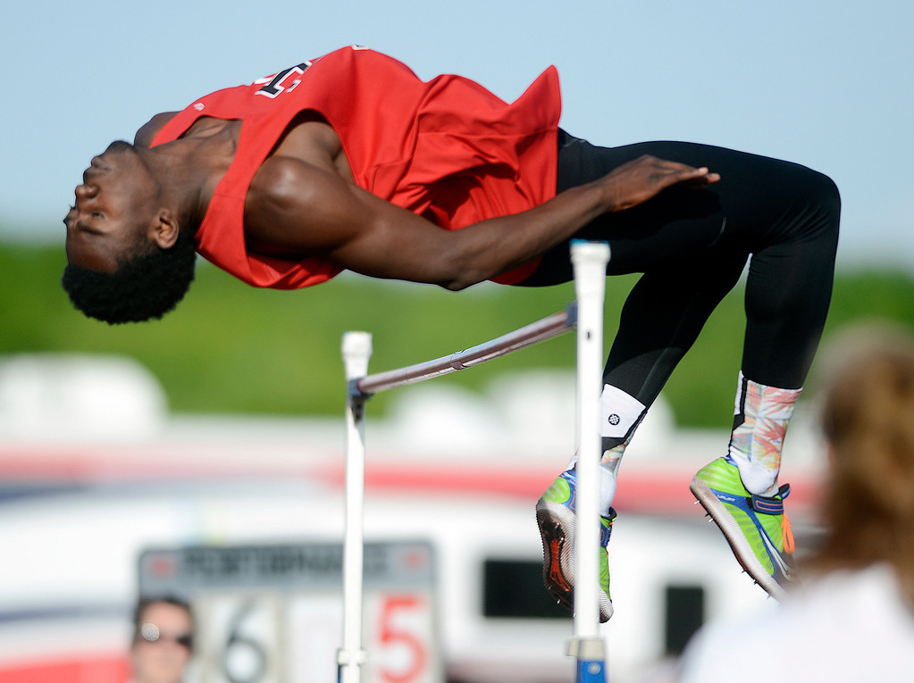 """. Maribeth Joeright/MJoeright@News-Herald.com<p> Harvey\'s Lavell Morgan qualifies for state with his jump of 6\'5\"""" during the boys high jump event during the Divison I regional final meet, May 30, 2014."""