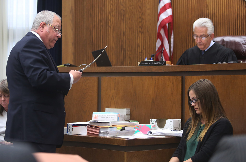 . Michael Allen Blair/MBlair@News-Herald.com Defense attorney Michael J. Connick examines the murder weapon during Kevin Knoefel\'s conspiracy trial in Lake County Common Pleas Court on  June 3, 2014.