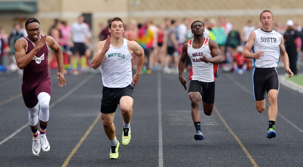 . Jeff Forman/JForman@News-Herald.com Andy Isabella, second from left, finishes in first place in the boys 100 meter dash, just ahead of second place Gino Hinton, Maple Heights, left, during the Mayfield 2014 Track and Field Invitaional May 9 at Mayfield High School. Fadonte Lewis, West Geuage, and Sam Guyett, South, finished fifth and sixth, respectively.