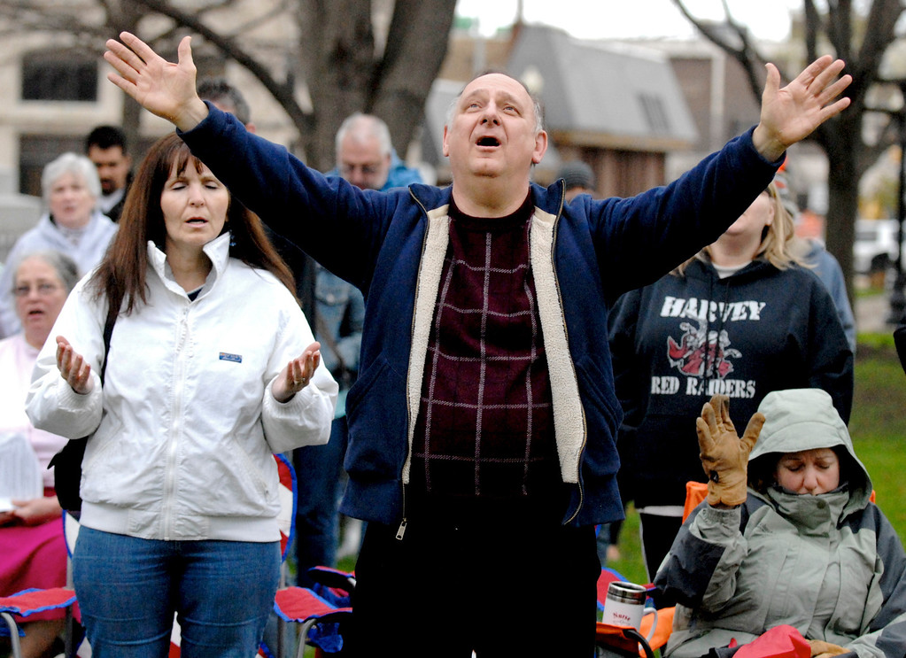 . Jeff Forman/JForman@News-Herald.com The Rev. James Porostosky sings and prays during a National Day of Prayer observance May 1 in Painesville.