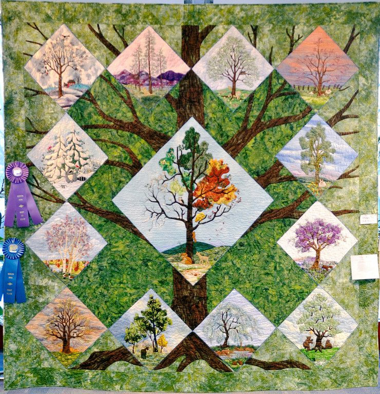 """. Jeff Forman/JForman@News-Herald.com \""""For the Love of Trees,\"""" by Shirley Tchou, of Pepper Pike, received Best of Show honors in the 23rd Annual Quilts 2014 show at Lake Metoparks Farmpark."""