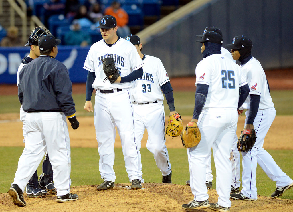 . Maribeth Joeright/MJoeright@News-Herald.com<p> Members of the Lake County Captains converge on the mound in the fourth inning of their opening game against Lansing. Staring pitcher Dace Kime pitched just three and one-third innings giving up six runs, five of them earned.
