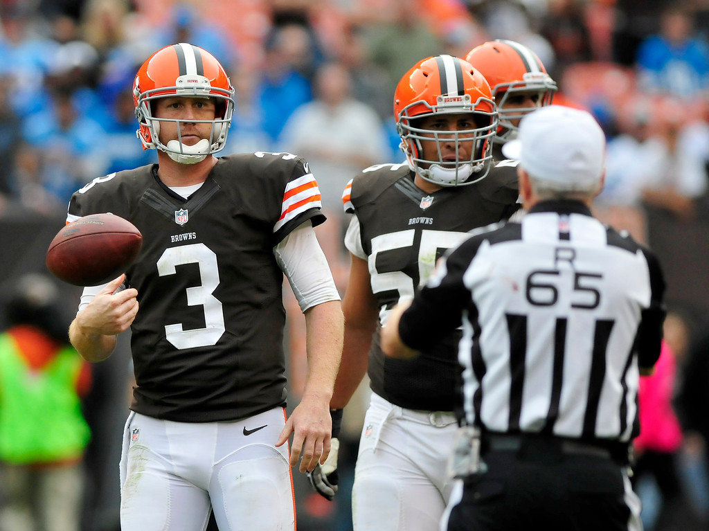 . Sam Greene/The Morning Journal Browns quarterback Brandon Weeden (3) tosses the ball to an official as he leaves the field during the fourth quarter of the NFL week six game between the Cleveland Browns and Detroit Lions at FirstEnergy Stadium in Cleveland, Ohio, on Sunday, Oct. 13, 2013. Weeden threw 26-for-43, tallying 292 yards, 2 touchdowns and 2 interceptions.