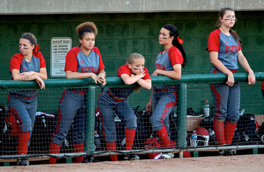 . Jeff Forman/JForman@News-Herald.com Elyria players show their disappointment as the Grove City dominates the game in the sixth inning.