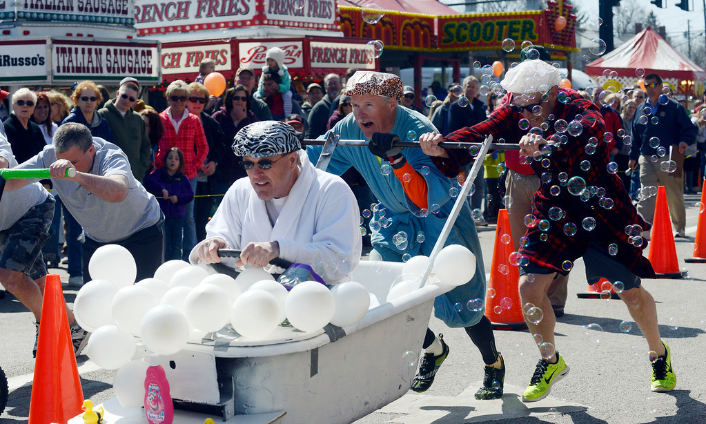 . Maribeth Joeright/MJoeright@News-Herald.com<p> The Maple Marauders bathtub race team comprised of Kevin Morgan at the wheel, Bob Baird, left, and Drew Vargo are shown at the starting line amid a sea of bubbles during the annual event at 85th annual Geauga County Maple Festival on Chardon Square, April 27, 2014. The Maple Marauders took best of show for the creative costumes.