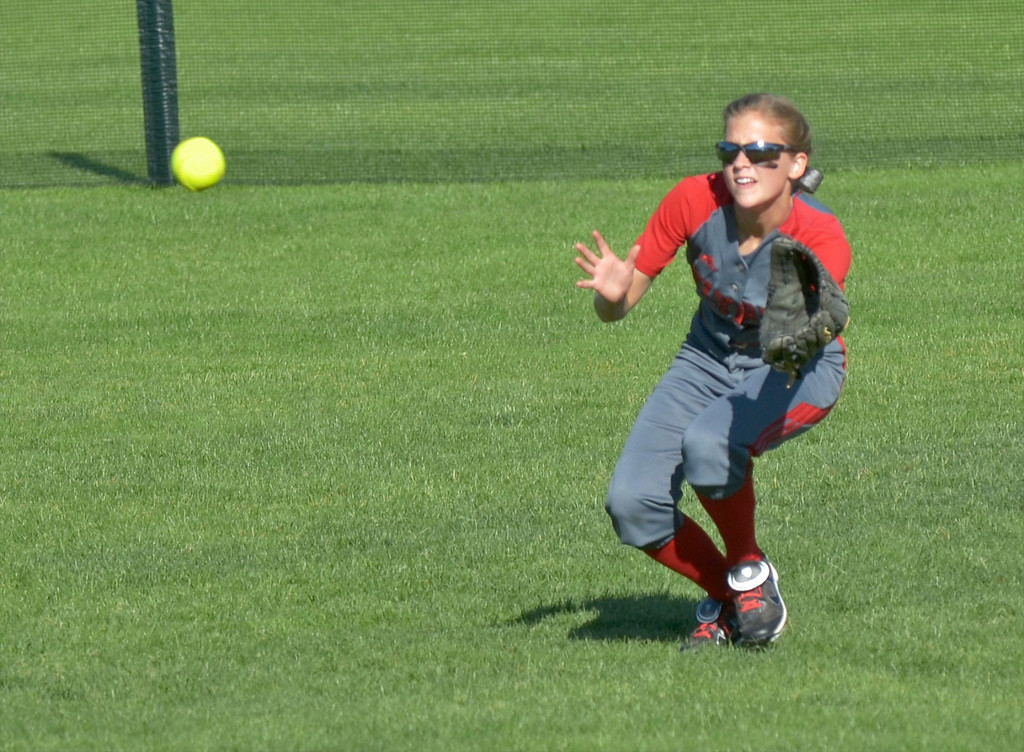 . Jeff Forman/JForman@News-Herald.com Elyria center fielder Jessica Sito catches a fly ball for an out in the fourth inning of the Pioneer\'s 9-1 state semi final loss June 5 at Firestone Stadium in Akron.