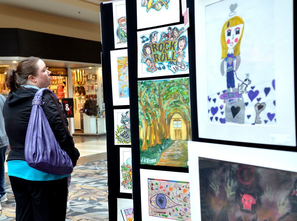 ". Jeff Forman/JForman@News-Herald.com Jacqueline Bryner, of Willoughby, visits the ""Expressions of Recovery\"" exhibit at the Great Lakes Mall. The show is sponsored by the Lake County ADAMHS Board."