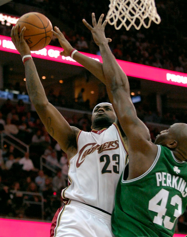 . Maribeth Joeright/MJoeright@News-Herald.com Cavaliers forward LeBron James shoots during overtime as Celtics forward Paul Pierce attempts to block his shot. James scored 38 points during Tuesday\'s game.