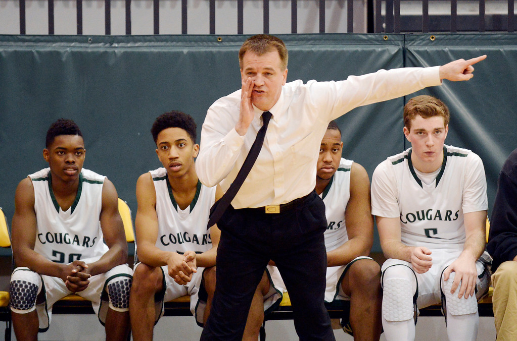 . Maribeth Joeright/MJoeright@News-Herald.com Lake Catholic coach Mark Chicone encourages his offense late in their game against Chagrin Falls in the Division II district final game, March 8, 2014.