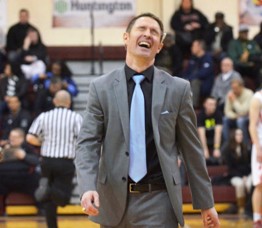 . Jeff Forman/JForman@News-Herald.com VASJ coach Babe Kwasniak celebrates the Vikings\' 82-71 win over Mentor Sunday in the Dunk4Diabetes Shootout at Walsh University in North Canton.