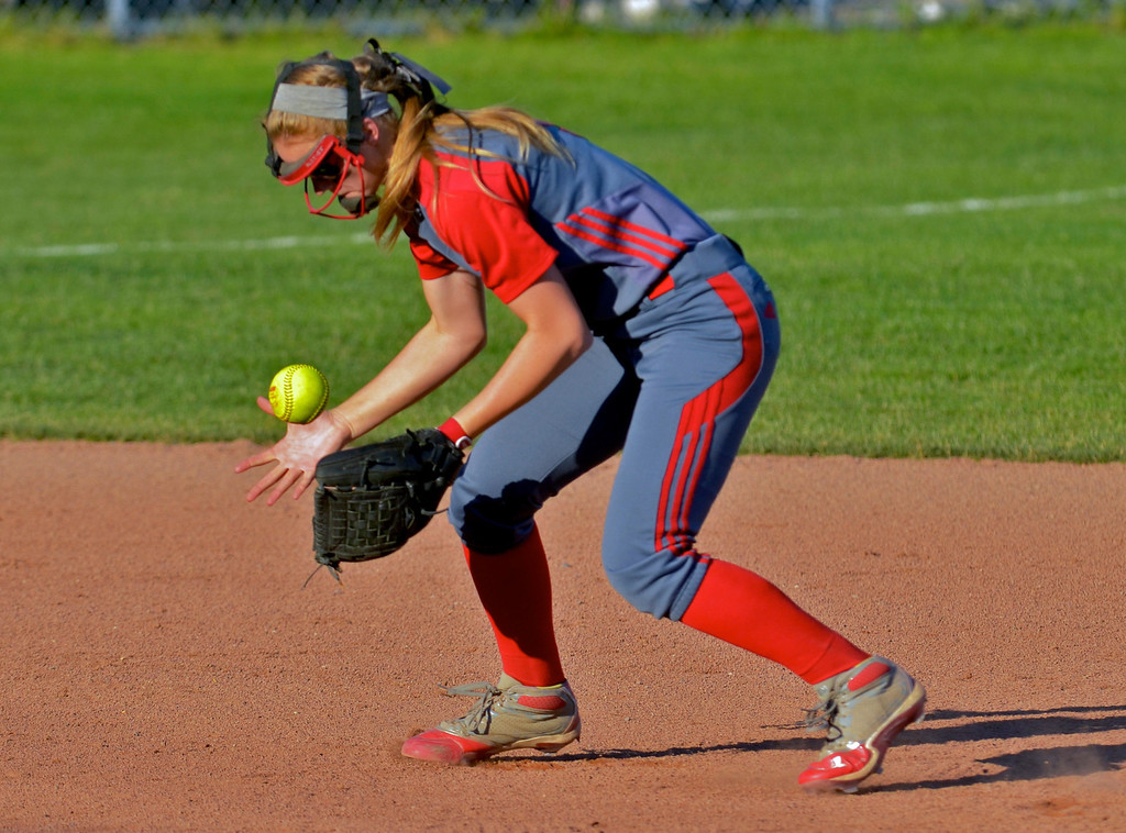 . Jeff Forman/JForman@News-Herald.com Elyria shortstop Carly Bachna bobbles the ball but still throws the runner out at first base in the fourth inning of the Pioneer\'s 9-1 state semi final loss June 5 at Firestone Stadium in Akron.