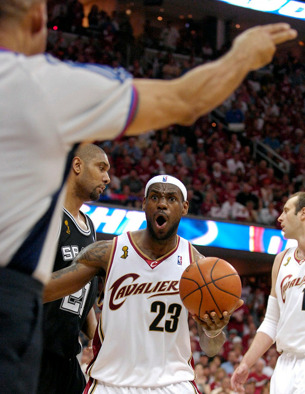 . Lebron James reacts to his third foul in the 2nd quarter and spent the last couple minutes on the bench Tuesday in Game 3 of the NBA Finals against the Spurs.