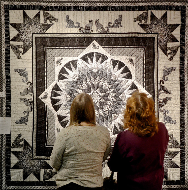 """. Jeff Forman/JForman@News-Herald.com Visitors to the Quilts 2014 show at Lake Metoparks Farmpark examine \""""Cat\'n Around\"""" by Roberta S. McAlister of Perry."""