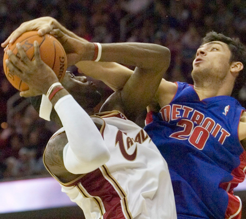 . MORNING JOURNAL/DAVID RICHARD LeBron James is fouled by Detroit\'s Carlos Delfino last night in the fourth quarter.