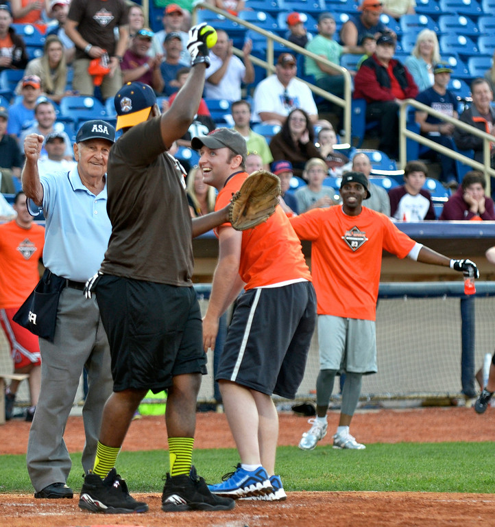 . Jeff Forman/JForman@News-Herald.com Matt Skrajner is out at the plate, despite his valient effort, during the Joe Haden and Friends Softball Game July 17 at Classic Park.