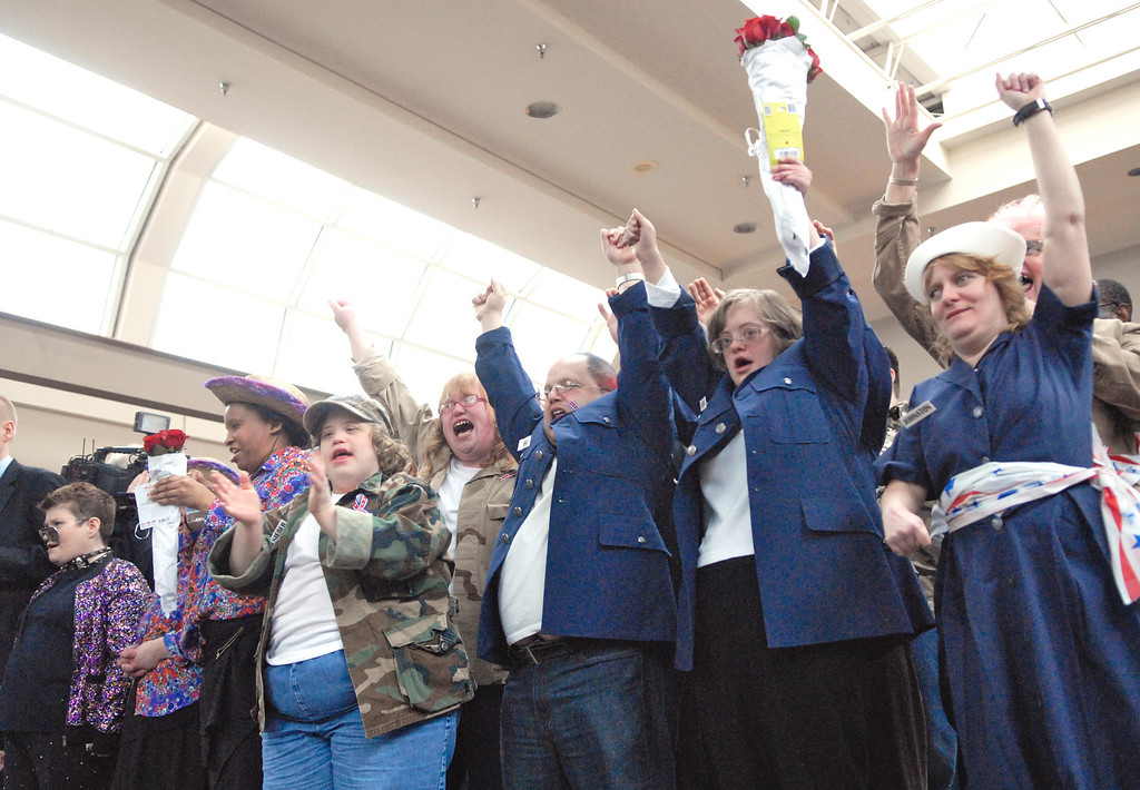 """. Jeff Forman/JForman@News-Herald.com Members of the \""""All American Group\"""" encore their performance of \""""God Bless the USA\"""" as they celebrate winning   Deepwood Idol March 29 at the Great Lakes Mall. The show was presented by the Lake County Board of Developmental Disabilities/Deepwood."""
