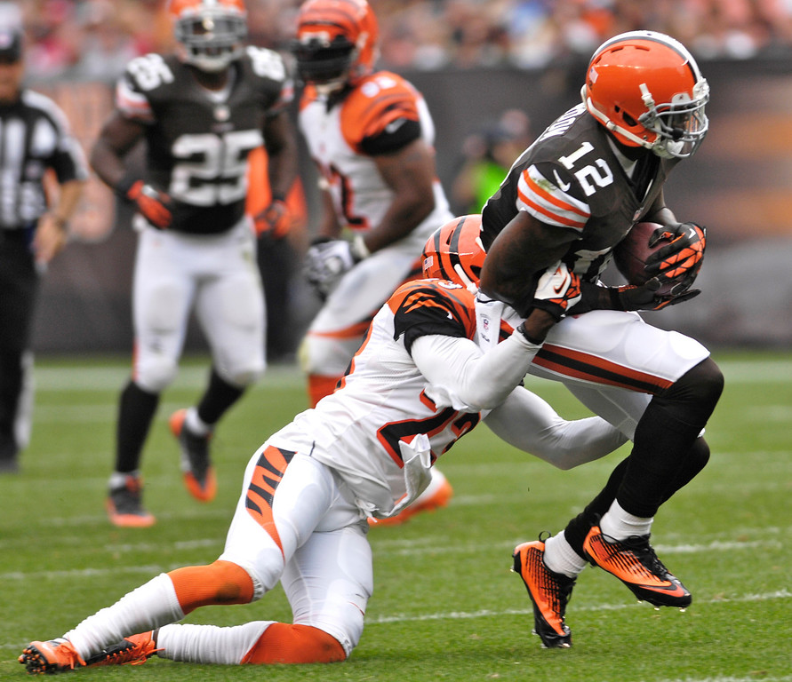 . Jeff Forman/JForman@News-Herald.com Browns wide receiver Josh Gordon is tackled by Bengals defender Terene Newman in the third quarter of the Browns\' 17-6 win Sunday at FirstEnergy Stadium.