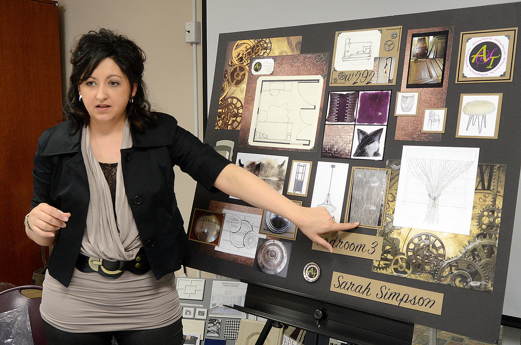 . Duncan Scott/DScott@News-Herald.com Sarah Simpson presents her design ideas for a bedroom in the 2014 Lake County YMCA Dreamhouse on April 7. This year\'s dreamhouse is a brownstone located at The Residences at Willoughby Pointe in downtown Willoughby. Photographing Stern\'s design is