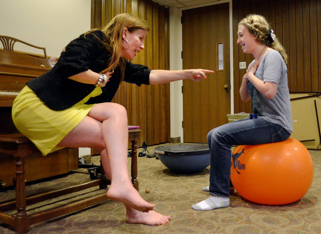 . Jeff Forman/JForman@News-Herald.com Michaela Quirk uses a stability ball to help focus her breathing as Skok leads her through an exercise.