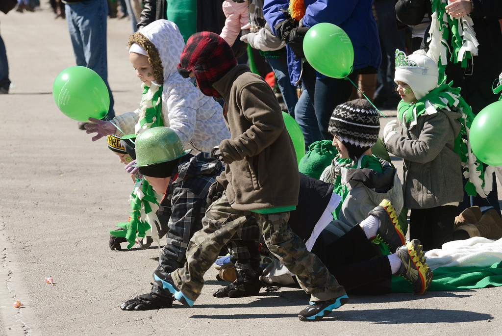 . Maribeth Joeright/MJoeright@News-Herald.com<p> A group of children from Mentor dive after some candy thrown on the parade route during the 147th annual event in Cleveland, March 17, 2014.