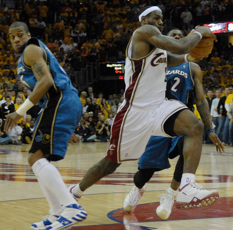 . Michael Blair/MBlair@News-Herald.com The Cavs\' LeBron James drives the lane past the Wizards\' Antonio Daniels, left, and DeShawn Stevenson with time running out in the fourth quarter of Wednesday\'s loss to the Wizards.