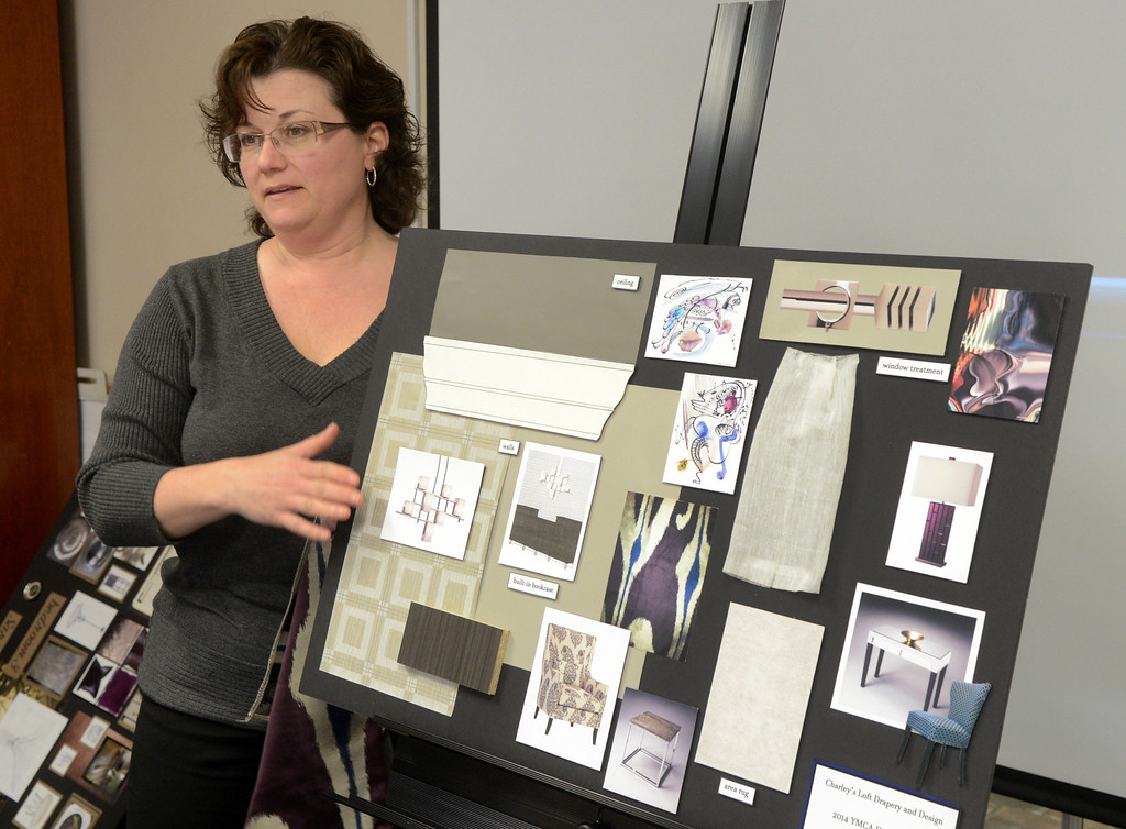 . Duncan Scott/DScott@News-Herald.com Halle Chiappone of Charley\'s Loft presents the design of the study for the 2014 Lake County YMCA Dream House.